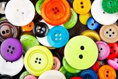 färgrik clothing för knappar Arkivfoto
