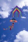 Färgrik drake i skyen Arkivfoto