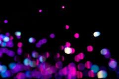 Färgrik feriebakgrund för neon med defocused ljus arkivbild