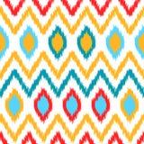 Färgrik geometrisk modell för etniskt ikatabstrakt begrepp i vit, guling, rött och blått, vektor Royaltyfri Bild