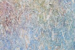 Färgrik gräsplan, blått, violeten, vit och guling målade OSB stiger ombord arkivfoton
