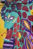 Färgrik grafittibild på en vägg Arkivfoto