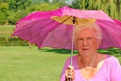 färgrik hög paraplykvinna royaltyfri fotografi