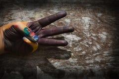 Färgrik hand och finger av barnspelrum Arkivfoto