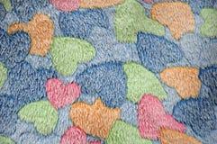 Färgrik hjärta mattt format golv royaltyfri bild