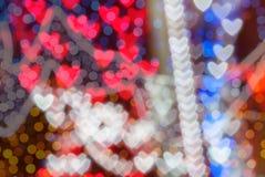 Färgrik hjärtabokehbakgrund Fotografering för Bildbyråer