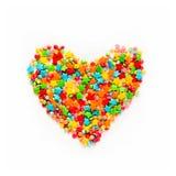 Färgrik hjärtaform av olika mångfärgade stänk Arkivfoton