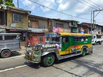 Färgrik jeepney Arkivbild
