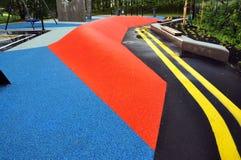 Färgrik jordning för utomhus- sportar i regnet Royaltyfria Bilder
