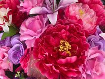 Färgrik konstgjord blomma, bakgrund och textur Arkivbilder