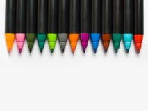färgrik linje pennor royaltyfri fotografi