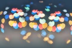 Färgrik linssignalljus i formen av hjärta Arkivbild