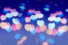 Färgrik linssignalljus i formen av hjärta Arkivfoton