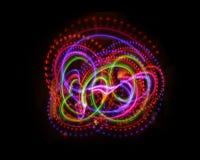 Färgrik ljus lysande textur på svart arkivfoto