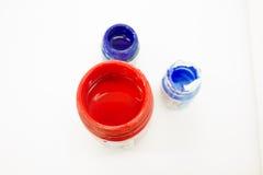 Färgrik målarfärg i runda flaskor Arkivfoto