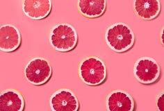 Färgrik modell av grapefruktskivor arkivfoto