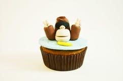 Färgrik muffin med ett apadiagram fotografering för bildbyråer