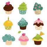 färgrik muffinset Arkivbild
