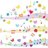 Färgrik musikdesign med notsystemet, fjärilar, hjärtor och blomman Royaltyfri Fotografi
