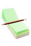färgrik notepaperblyertspenna fotografering för bildbyråer