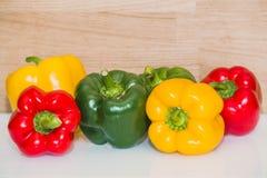 Färgrik paprika på den ljusa bakgrunden Arkivbild