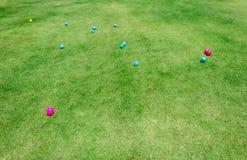 Färgrik plast- boll på gräsmattan i lekplatsen royaltyfria foton