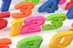 Färgrik plast- numrerar 123 på vit Royaltyfri Fotografi