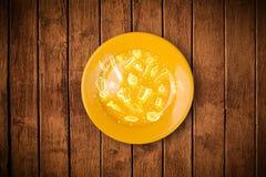 Färgrik platta med hand dragen symboler, symboler, grönsaker och fr Royaltyfria Foton
