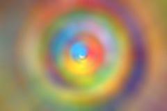 Färgrik radiell snurrandeabstrakt begreppbakgrund Royaltyfria Bilder