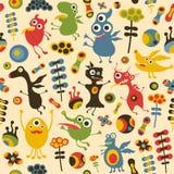 Färgrik sömlös modell med lyckliga monster och blommor Arkivbild