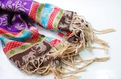 Färgrik sjal på vit bakgrund royaltyfri bild