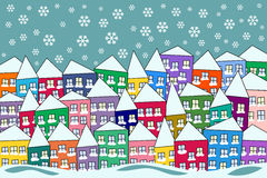 Färgrik snöig byvinterplats Royaltyfria Bilder