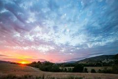 färgrik solnedgång Royaltyfri Bild