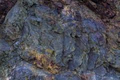 Färgrik stentexturbakgrund Arkivfoto