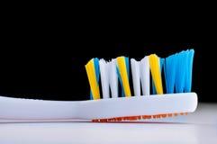 Färgrik tandborste på svart bakgrund Fotografering för Bildbyråer