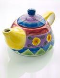 färgrik teapot arkivbilder