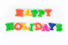Färgrik text för lyckliga ferier på en vit Arkivbilder