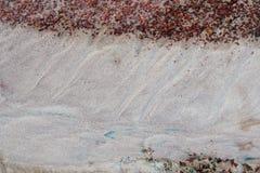 Färgrik textur för sand Arkivfoto