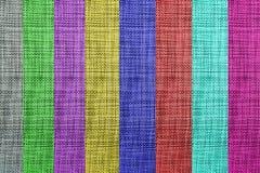 Färgrik texturerad tygbakgrundskonst arkivfoto