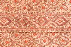 Färgrik thai siden- textur Arkivfoton