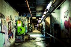 Färgrik tunnel med grafitti Arkivfoto