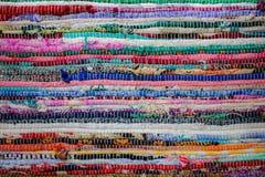 Färgrik tygbakgrund, textilmodell textur royaltyfria foton