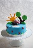 Färgrik ungefödelsedagkaka Fotografering för Bildbyråer