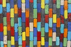färgrik vägg för tegelsten Arkivfoto