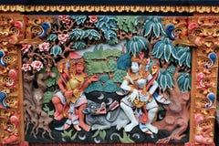 Färgrik väggmålning av Ramayana den hinduiska myten i Bali Arkivfoton