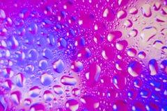 Färgrik vätskeliten droppebakgrund Arkivbilder