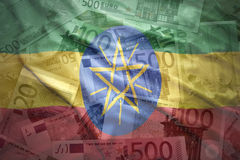 Färgrik vinkande ethiopian flagga på en eurobakgrund Royaltyfri Fotografi