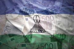 Färgrik vinkande Lesotho flagga på en eurobakgrund Royaltyfria Bilder