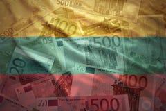 Färgrik vinkande lithuanian flagga på en eurobakgrund Fotografering för Bildbyråer