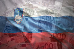 Färgrik vinkande slovenian flagga på en eurobakgrund Royaltyfri Bild